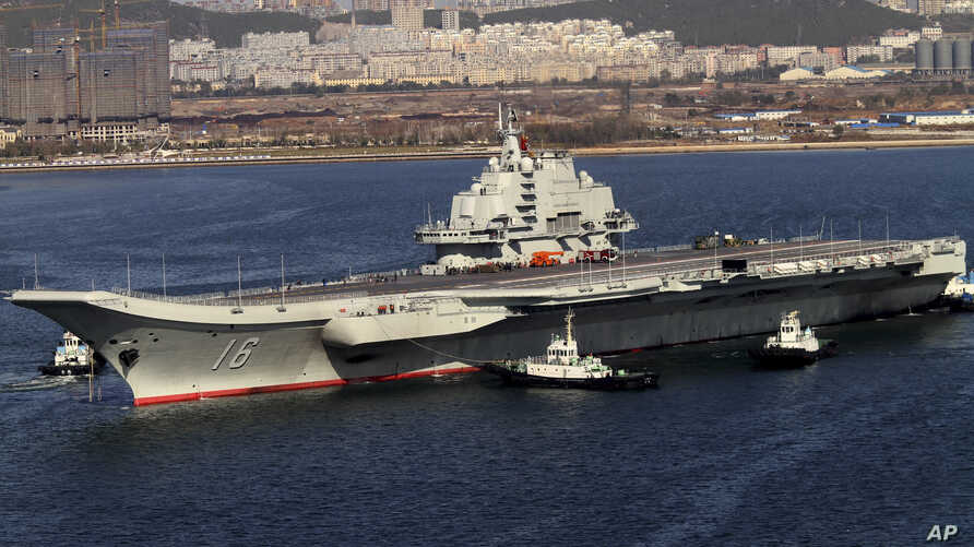 Chinese aircraft carrier Liaoning cruises back to port after its first navy sea trial in Dalian, northeastern China, Oct. 30, 2012.