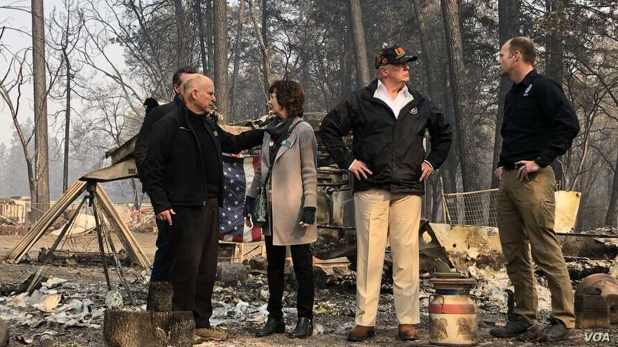 U.S. President Donald Trump visits the wreckage of a mobile home park in Paradise, Calif., Nov. 17, 2018, with Federal Emergency Management Agency Administrator Brock Long, right. At left, California Gov. Jerry Brown talks with Paradise Mayor Jody Jo
