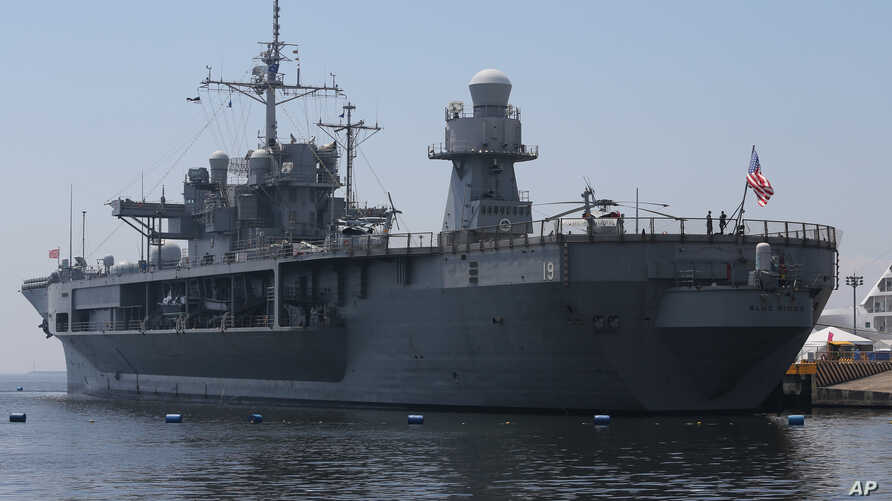 """The USS Blue Ridge is seen in Manila, March 6, 2016. Several of those indicted in the """"Fat Leonard"""" bribery scandal served aboard the Blue Ridge."""