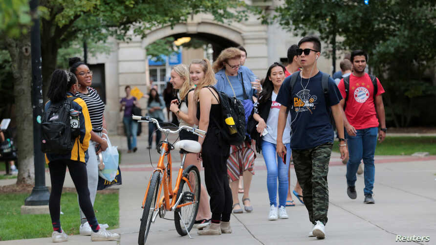 FILE - Students walk on campus at the University of Michigan in Ann Arbor, Michigan, Sept. 19, 2018.
