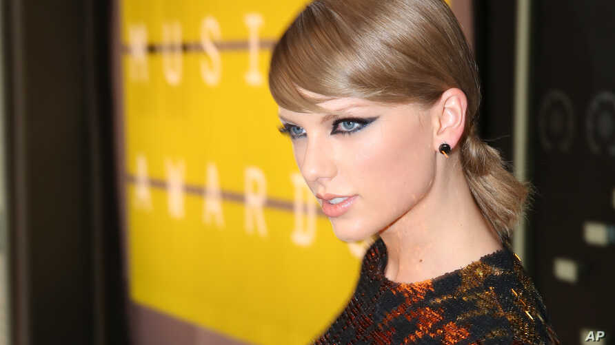 FILE - Taylor Swift arrives at the MTV Video Music Awards at the Microsoft Theater. Swift filed a counterclaim Wednesday in a groping lawsuit.