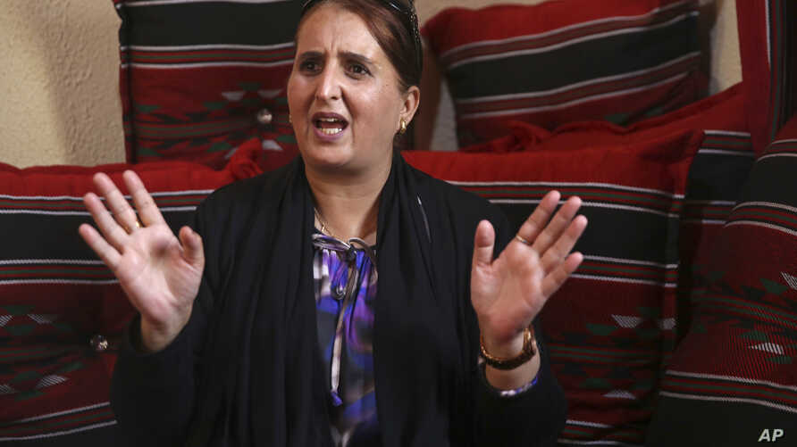 """Taghreed Abu Teer, recalls being held by Hamas authorities for 11 days and interrogated under """"humiliating circumstances"""" for her activities with the rival Fatah movement during an interview with The Associated Press at a relative's home in Khan Youn"""