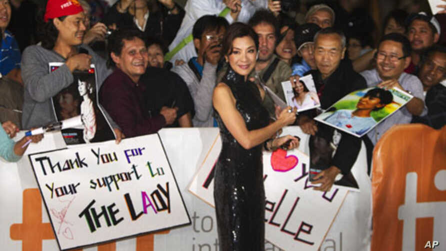 "Cast member Michelle Yeoh greets fans on the red carpet for the film ""The Lady"" during the 36th Toronto International Film Festival (TIFF) September 12, 2011."