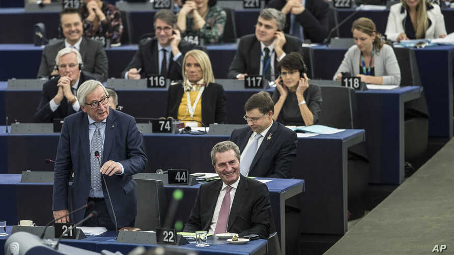European Commission President Jean-Claude Juncker, left, speaks at the European Parliament in Strasbourg, eastern France, Nov.13, 2018. British and Irish media say U.K. and EU negotiators have reached an agreement on a proposed Brexit deal to resolve...