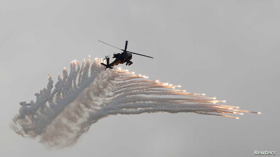 AH-64 Apache helicopter fires flares during Han Kuang military drill simulating the China's People's Liberation Army invading the island, at Ching Chuan Kang Air Base, in Taichung, Taiwan, June 7, 2018.