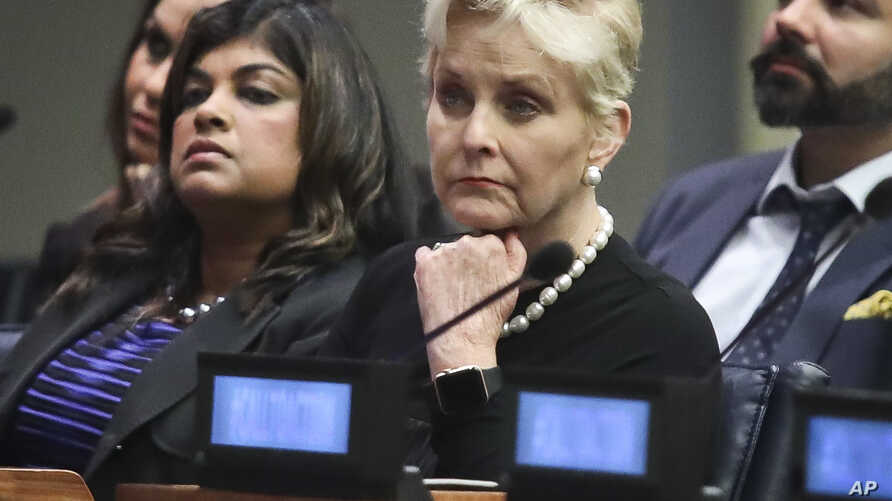 FILE - Cindy McCain (C), co-chair of the McCain Institute's Human Trafficking Advisory Council, and trafficking survivor Rani Hong (2nd-L), listen after addressing the human rights conference during the United Nations General Assembly at U.N. headqua