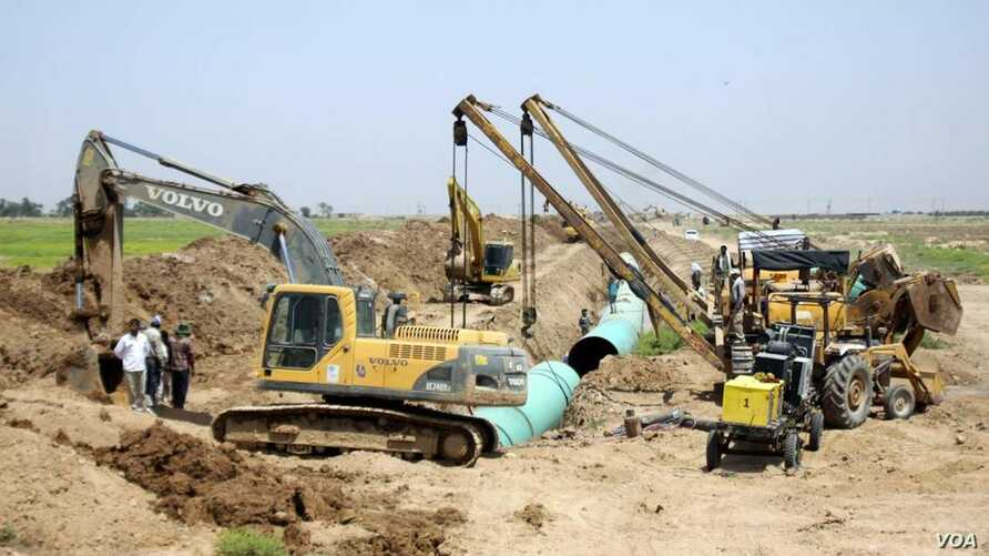 Iranian construction crews work on a water distribution project called Ghadir in the southwestern province of Khuzestan, July 2, 2018. The project is aimed at resolving clean-water shortages that triggered several days of mass streets protests in the