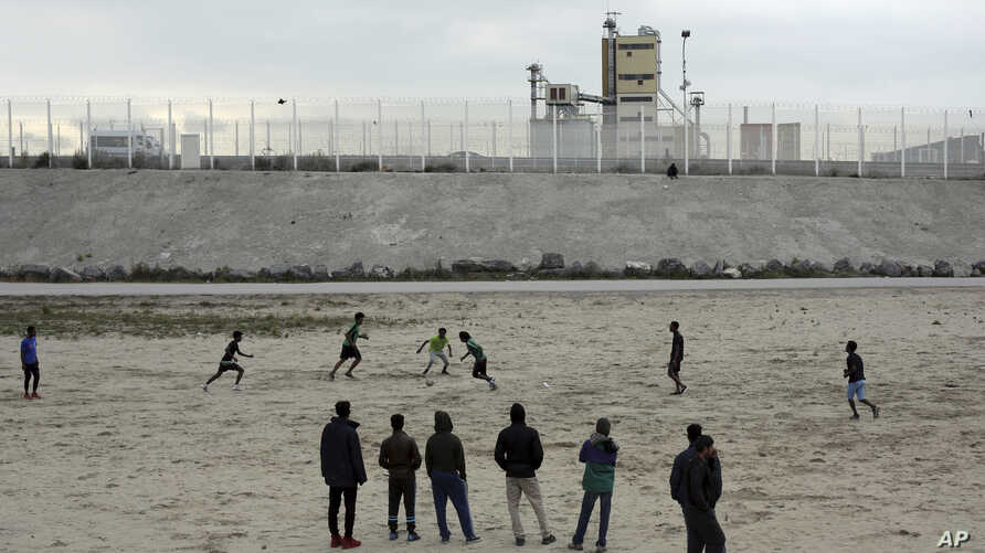 "Migrants play soccer in a makeshift camp that has been dubbed ""Jungle"" by its residents, in Calais, France, Oct. 12, 2016."
