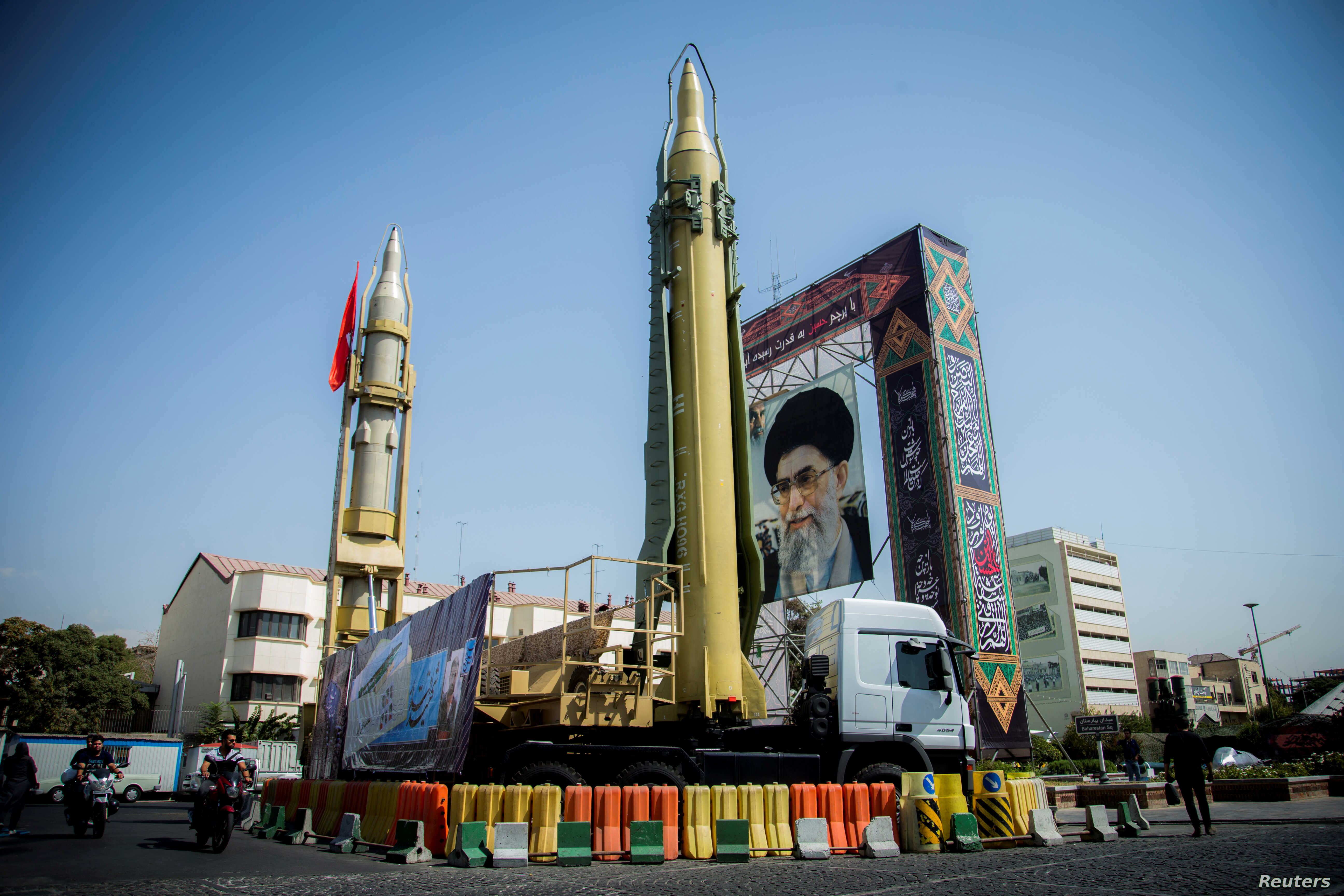 FILE PHOTO: A display featuring missiles and a portrait of Iran's Supreme Leader Ayatollah Ali Khamenei is seen at Baharestan Square in Tehran, Iran Sept. 27, 2017.