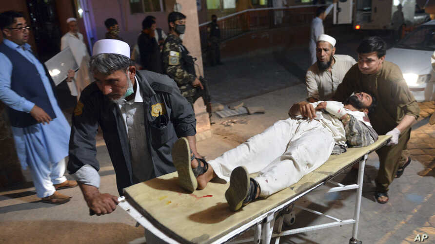 A wounded man is brought by stretcher into a hospital in Jalalabad city, capital of Nangarhar province, east of Kabul, June 16, 2018.