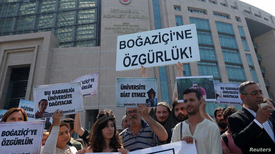 """Protesters demonstrate outside a court as they demand the release of 14 college students who are on trial for opposing Turkey's incursion in northern Syria against the Kurdish YPG militia in Istanbul, Turkey, June 6, 2018. The top banner reads: """"Free"""