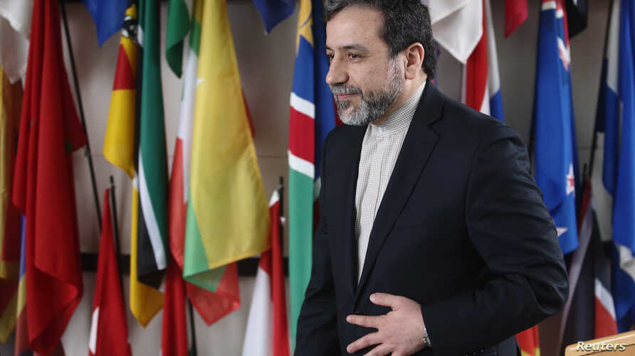 Iran's chief nuclear negotiator Abbas Araghchi leaves after giving a statement after meeting IAEA Director General Yukiya Amano (not pictured) at the IAEA headquarters in Vienna, Feb. 24, 2015.