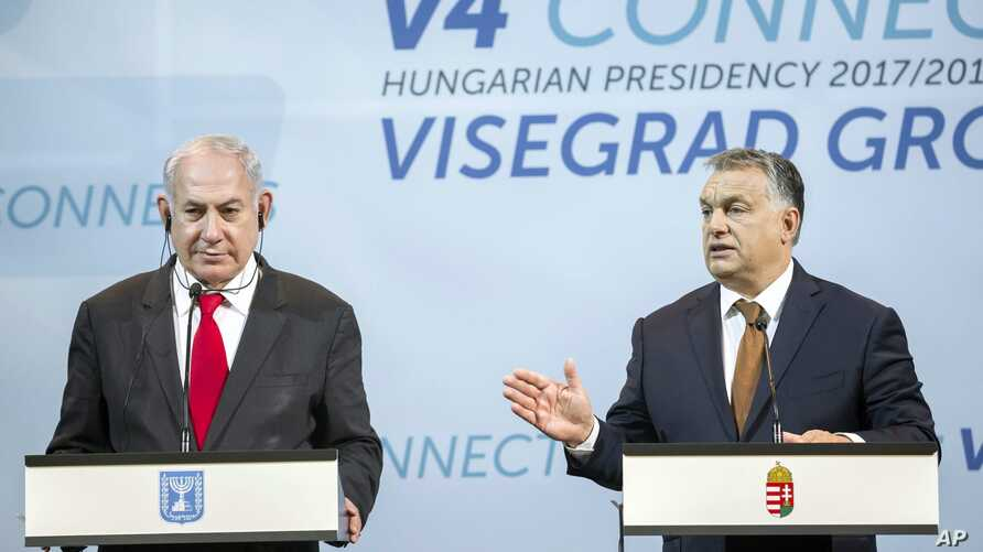 Israeli Prime Minister Benjamin Netanyahu, left, listens to Hungarian Prime Minister Viktor Orban during a press conference held after the talks of Netanyahu with heads of government of the Visegrad Group or V4 countries in the Pesti Vigado building