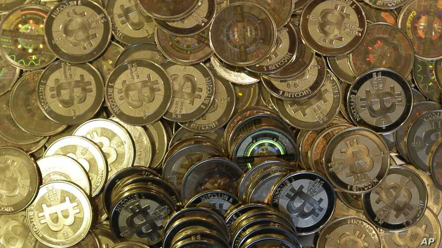 FILE - Bitcoin tokens at 35-year-old software engineer Mike Caldwell's shop in Sandy, Utah, April 3, 2013.