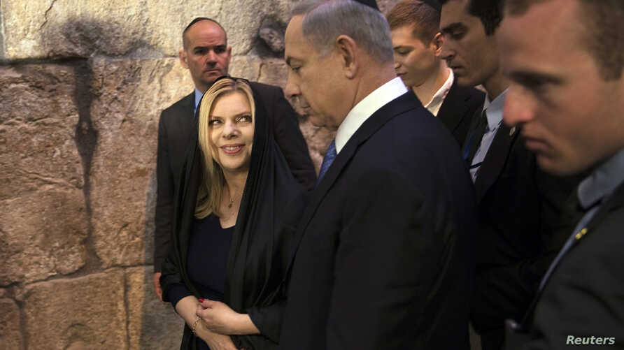 Israel's Prime Minister Benjamin Netanyahu (C) leaves with his wife Sara after he delivered a statement to the media at the Western Wall, Judaism's holiest prayer site, in Jerusalem's Old City March 18, 2015. Netanyahu won a come-from-behind victory ...