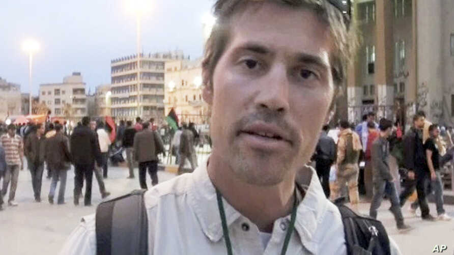 FILE - This undated file still image from video released April 7, 2011, by GlobalPost, shows James Foley of Rochester, N.H., a freelance contributor for GlobalPost, in Benghazi, Libya.