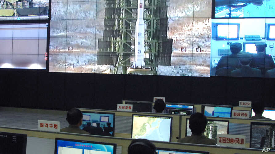 FILE - Scientists and technicians work on their computers to control a rocket launch at the General Satellite Control and Command Center Dec. 12, 2012, in Pyongyang, North Korea.