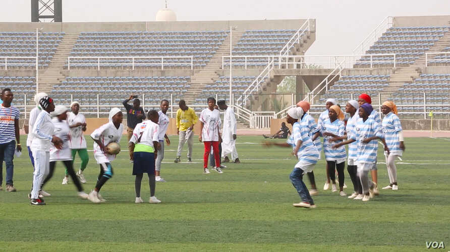 These female rugby players, a rare sight in Nigeria, are among the only two all-girl teams in the northern Nigerian state of Kano. They competed at the Second Annual Kano Youth Rugby Championships on Feb. 16, 2017. (Photo by Chika Oduah/VOA)