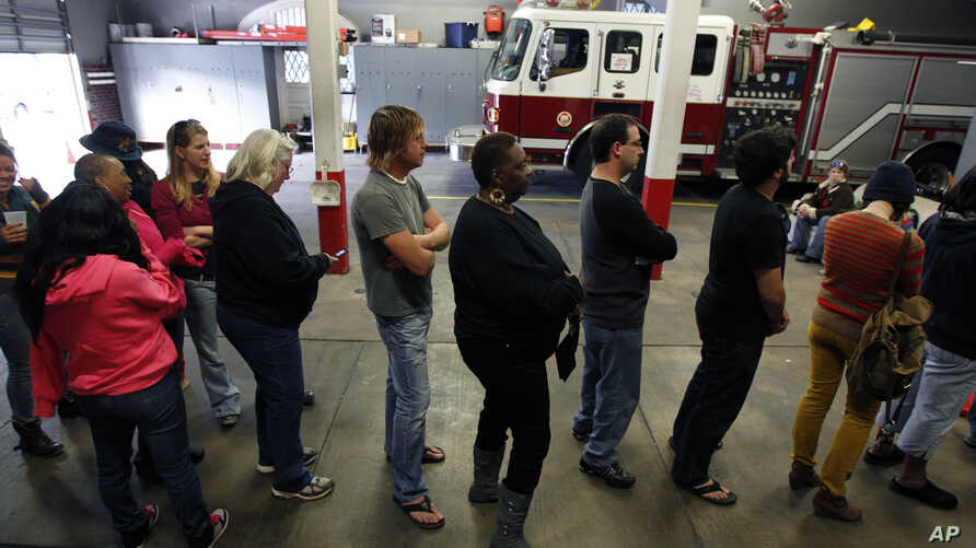 Voters line up at the Engine 26 Ladder 9 firehouse to vote on Election Day in New Orleans, Louisiana, November 6, 2012.
