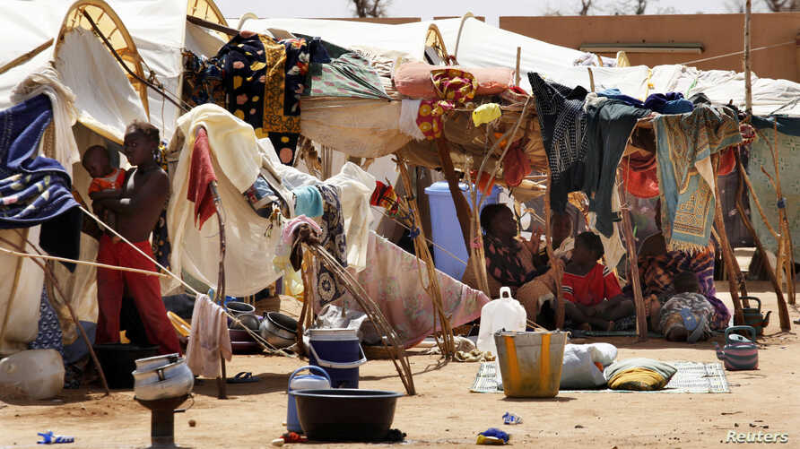 Malians displaced by war gather at a makeshift camp in Sevare, about 600 kms (400 miles) northeast of the capital Bamako, July 11, 2012.