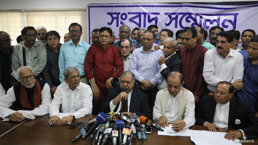 Members of Jatiya Oikyafront, an opposition alliance, hold a news conference at the National Press Club to confirm their participation in the upcoming parliamentary election in Dhaka, Bangladesh, Nov. 11, 2018.