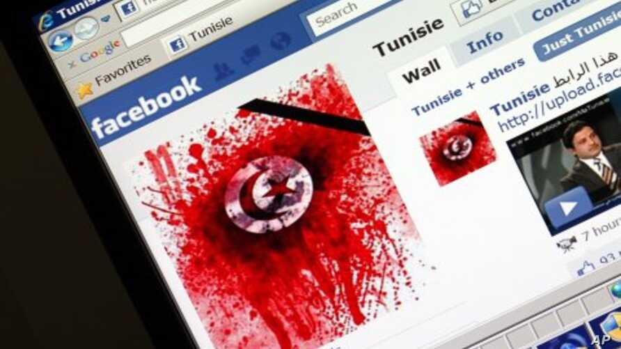 A student-run Facebook page shows an image depicting the Tunisian national flag smeared in red on a computer screen, 11 Jan 2011.