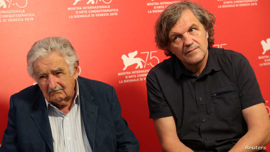 Director Emir Kusturica and former Uruguayan president Jose Mujica are interviewed by Reuters at the 75th Venice International Film Festival, Venice, Italy, Sept. 3, 2018.