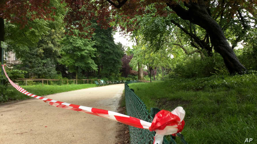 White-and-red tape is strung across a sandy pathway through Park Monceau after a lightning stike, in Paris, May 28, 2016.