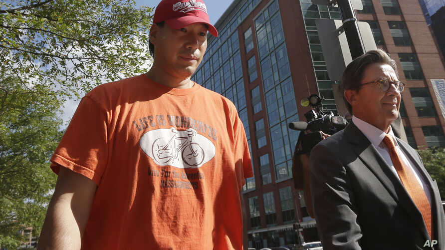 Glenn Adam Chin, left, a former supervisory pharmacist at the New England Compounding Center, walks with his attorney Paul Shaw, right, after appearing in federal court, Thursday, Sept. 4, 2014.
