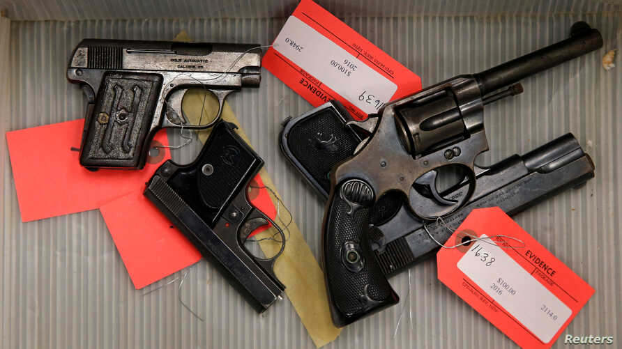 FILE - Handguns given up by the public as part of a gun turn-in where a gift card is given for every firearm turned over to Chicago Police are seen in a box at Universal Missionary Baptist Church in Chicago, Illinois, May 28, 2016.