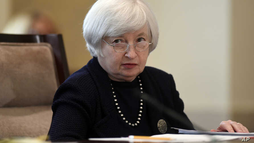 Federal Reserve Chair Janet Yellen attends a Board of Governors meeting at the Federal Reserve in Washington, Sept. 3, 2014.