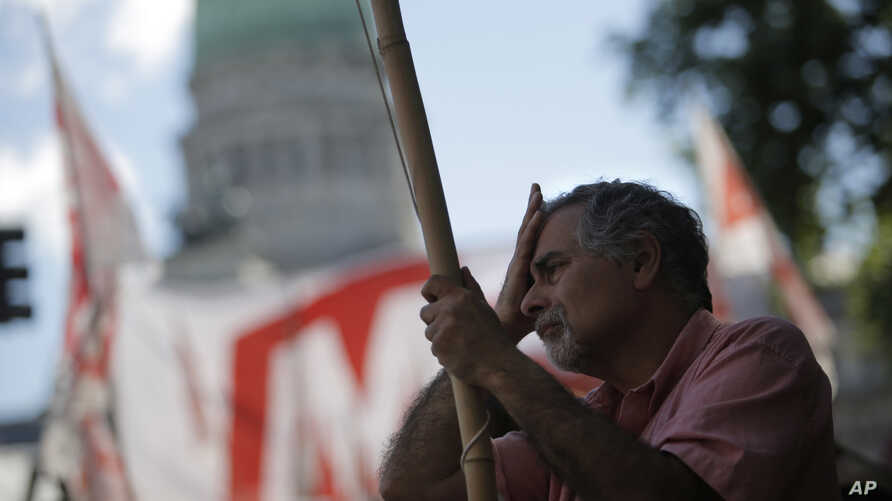 """Under the slogan: """"There is another way"""", unions, and political and social groups, gather to protest against the proposed 2019 budget they refer to as the budget of """"hunger, misery and unemployment,"""" in Buenos Aires, Argentina, Nov. 14, 2018."""