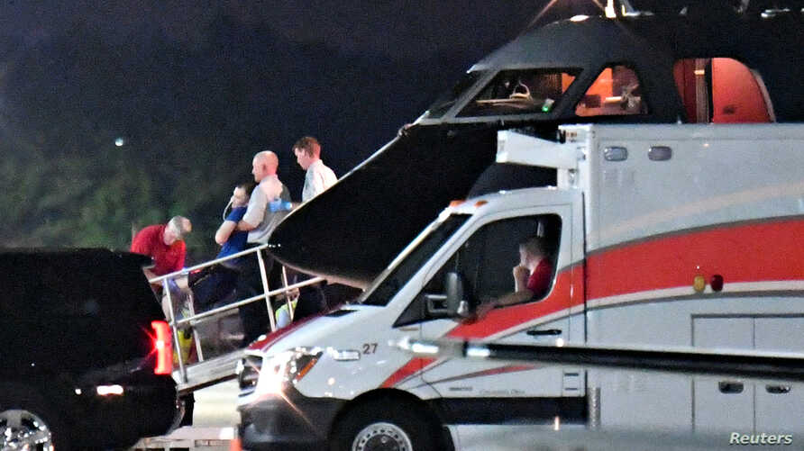 A person believed to be Otto Warmbier is transferred from a medical transport airplane to an awaiting ambulance at Lunken Airport in Cincinnati, Ohio, U.S., June 13, 2017.