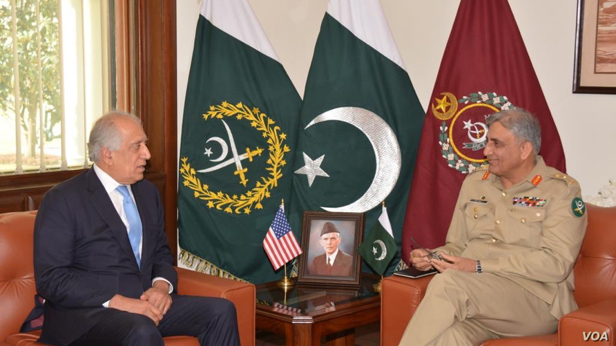 In this photo released by Inter Services Public Relations of Pakistan's military, U.S. peace envoy Zalmay Khalilzad, left, talks with Pakistani Army Chief Gen. Qamar Javed Bajwa during a meeting in Rawalpindi, Pakistan, Dec. 19, 2018.