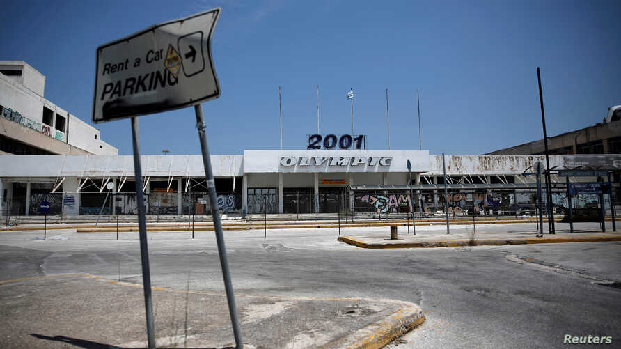 FILE - A view of the main entrance of the former international Hellenikon airport in Athens, Greece, July 16, 2017. Developers are one step closer to turning the site into a coastal resort.