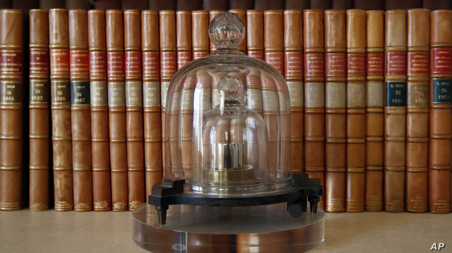 FILE - A replica of the International Prototype Kilogram is pictured at the International Bureau of Weights and Measures, in Sevres, near Paris, Oct. 17, 2018.
