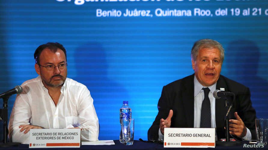Mexico's Foreign Minister Luis Videgaray (L) and Organization of American States (OAS) Secretary General Luis Almagro hold a news conference ahead of the OAS 47th General Assembly in Cancun, Mexico, June 19, 2017.