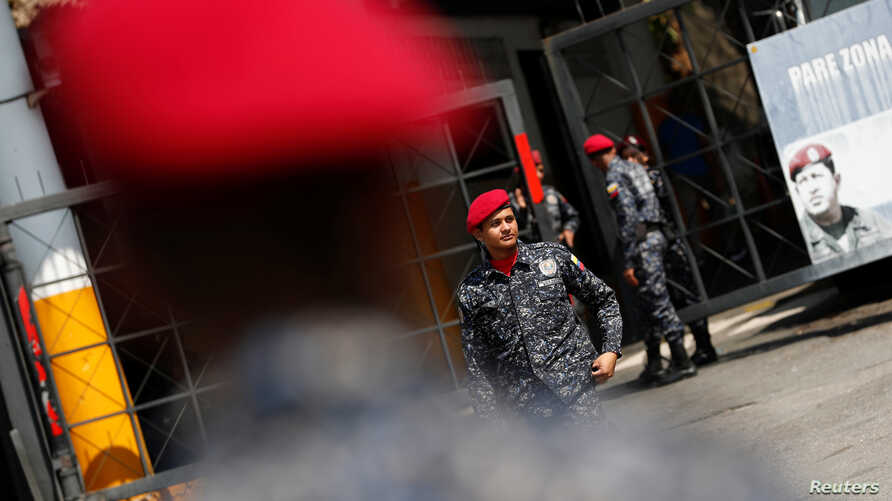 Police officers guard the entrance to the detention center of the Bolivarian National Intelligence Service (SEBIN) in Caracas, Venezuela March 21, 2019.