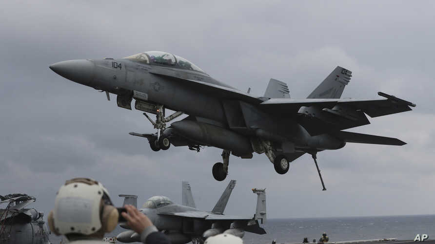 A U.S. Navy's F/A-18 Super Hornet fighter approaches the deck of the Nimitz-class aircraft carrier USS Carl Vinson during the annual joint military exercise between South Korea and the United States, March 14, 2017.