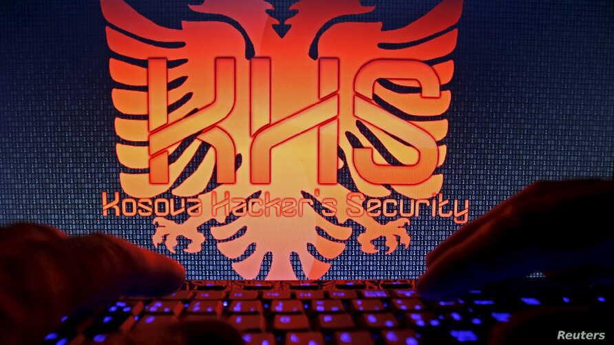 "A man types in front of the logo of the ""Kosova Hackers Security"" in this photo illustration taken in Sarajevo, Bosnia and Herzegovina, Oct. 16, 2015. Ardit Ferizi, arrested in Malaysia on charges of stealing information on Americans, is thought to b"