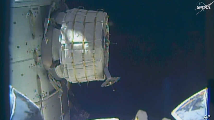 In this frame from NASA TV, a new experimental room at the International Space Station partially inflates Thursday, May 26, 2016. NASA released some air into the experimental inflatable room, but put everything on hold when problems cropped up.