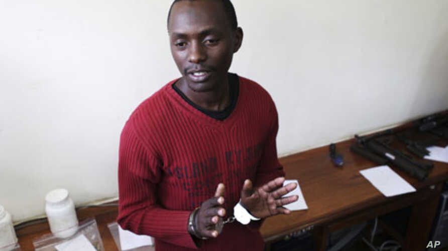 Kenyan Elgiva Bwire Oliacha alias Mohamed Seif reacts after his sentencing in Nairobi, October 28, 2011.