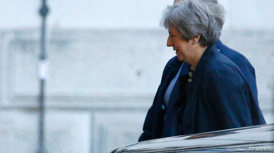 Britain's Prime Minister Theresa May arrives at Downing Street in London, Britain, Oct. 22, 2018.