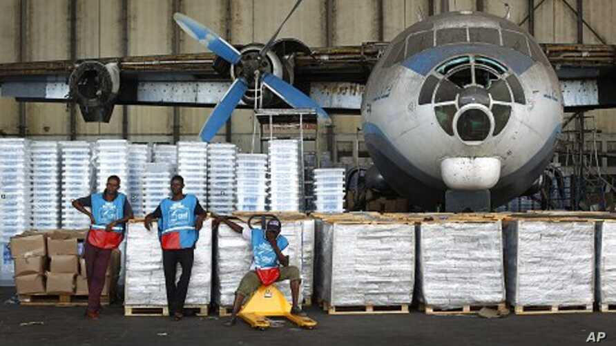 Congolese National Independent Electoral Commission workers wait to load planes and helicopters with election related equipment and ballots at Kinshasa Airport in Kinshasa, Democratic Republic of Congo, November, 25, 2011.   election related equip