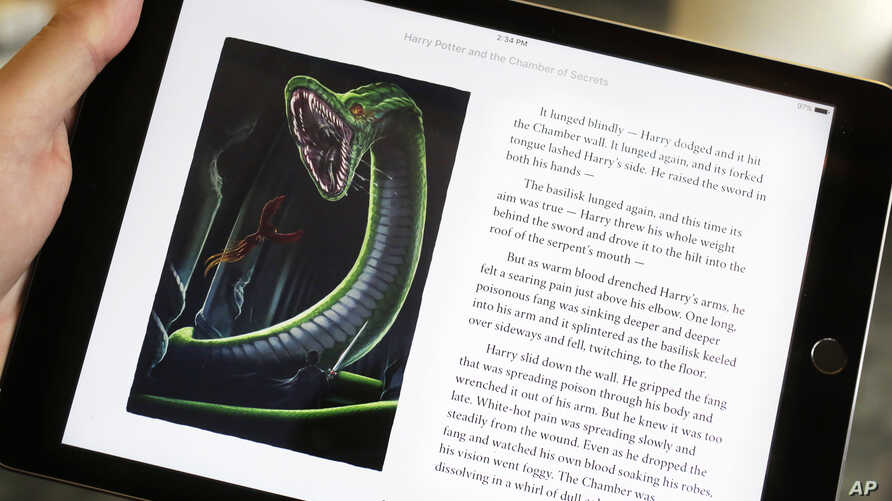 """Text and an illustration from """"Harry Potter and the Chamber of Secrets"""" are displayed on an iPad, Sept. 30, 2015, in New York."""
