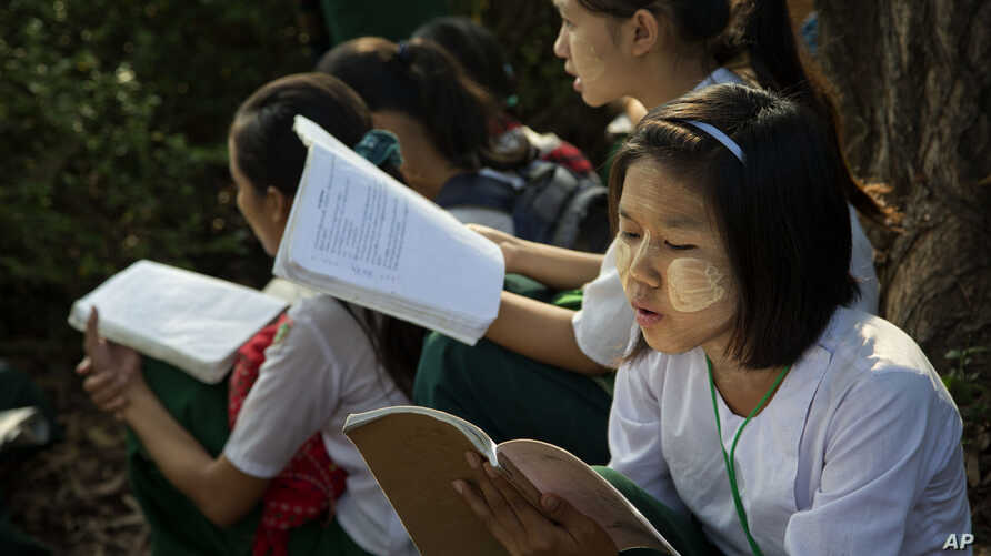 Students prepare for an exam in suburbs of Yangon, Myanmar, Feb. 19, 2016.