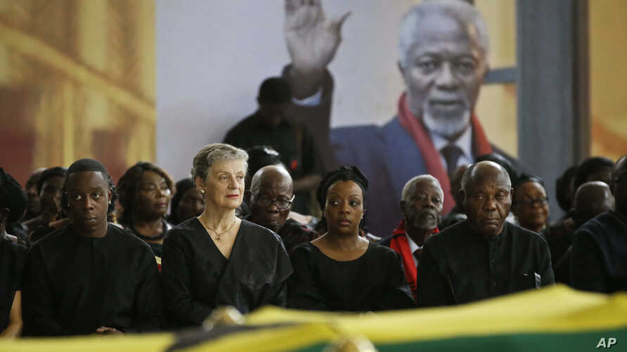 Kofi Annan's son Kojo Annan, left, widow Nane Annan, 2nd left, and daughter Ama Annan, center, join other family members to pay their respects as the coffin of former U.N. Secretary-General Kofi Annan lies in state at the Accra International Conferen