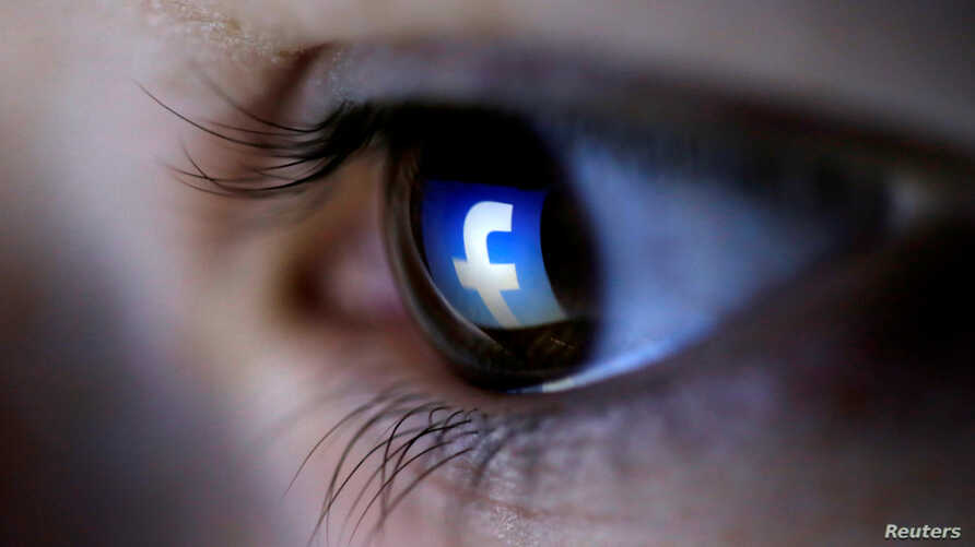 FILE -  A picture illustration shows a Facebook logo reflected in a person's eye.