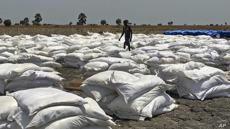 Bags of food dropped by air from a World Food Program plane are sorted in Padeah, South Sudan. South Sudanese who fled famine and fighting in Leer county emerged from South Sudan's swamps after months in hiding to receive food aid.