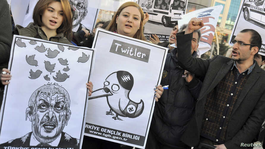 Demonstrators, members of the Turkish Youth Union, shout anti-government slogans during a protest against a Twitter ban, in Ankara, March 21, 2014.